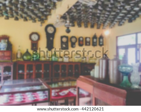 Blur image background, Various antique clocks vases and candlesticks on display - stock photo