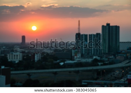 blur image city during warm sunset