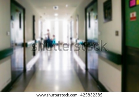 Blur image of a mother and daughter walking on the corridor in the hospital.