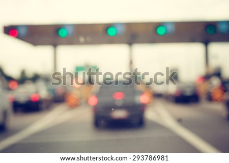 Blur image of car queue in front of express way gate - stock photo