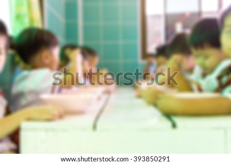 Blur image of children are eating use for background.