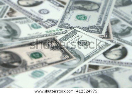 blur image of dollar banknotes