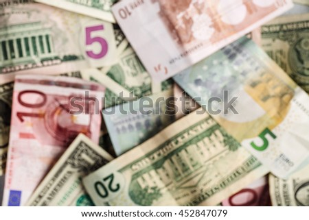blur image of euros and dollars banknotes. concepts of finance and business. - stock photo