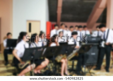 Blur image of group of Musicians Chorale and actor in universities