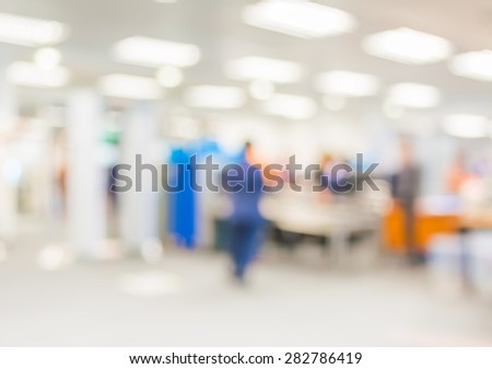 Blur image of immigration in airport with bokeh - stock photo
