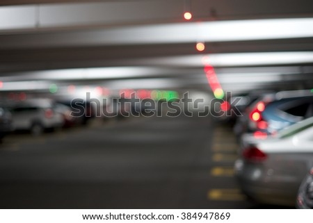 BLUR IMAGE OF INDOOR PARKING SPACE WITH CAR PARKING SPACE LED INDICATOR - stock photo