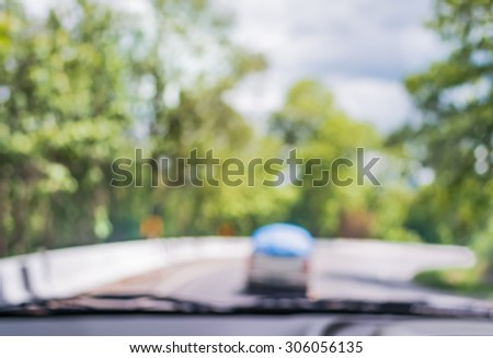 blur image of inside cars to see the road  with bokeh lights for background usage.