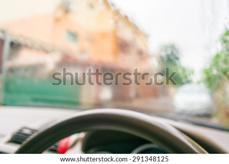 blur image of inside cars with bokeh during raining on day time. - stock photo