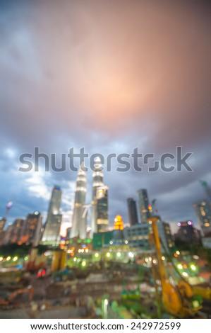 Blur image of Kuala Lumpur city with bokeh - stock photo