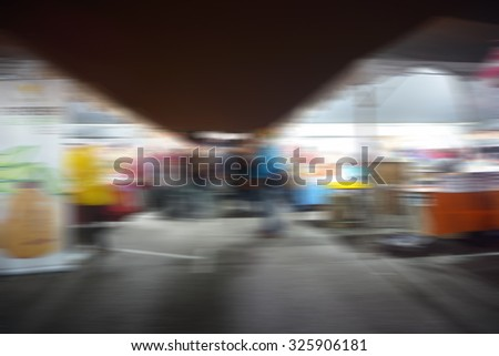 Blur Image of people at the night market. Defocus background