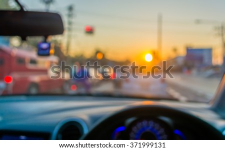 blur image of people driving car on day time for background usage.(take photo from inside).