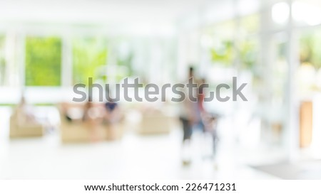 blur image of people sit in living room . - stock photo