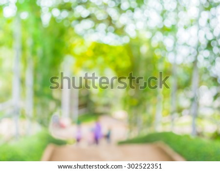 blur image of  people walking at stairway with open space to the green garden  for background usage . - stock photo