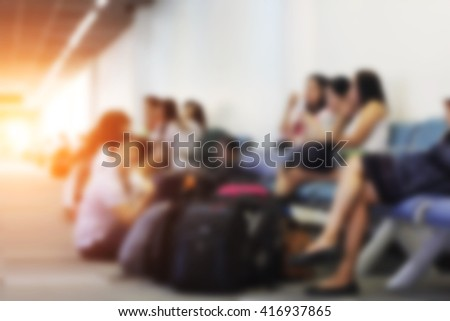 Blur image of People were waiting to board the plane to get to their destination and light - stock photo