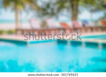 Blur image of swimming pool in a beautiful beach resort, Hua Hin, Thailand. - stock photo