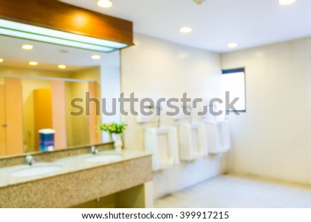 Blur image of the man toilet , use for background.