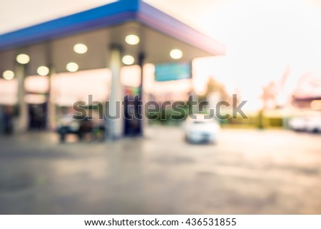 Blur image of twilight gas station at sunset. - stock photo