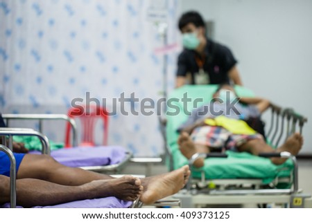 blur image of  urgently patients   in the emergency room at hospital. - stock photo