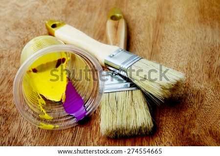blur image of watercolor and paintbrushes - stock photo