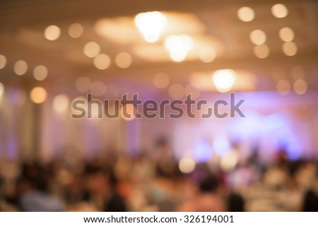 blur image of wedding party in large hall for background usage - stock photo