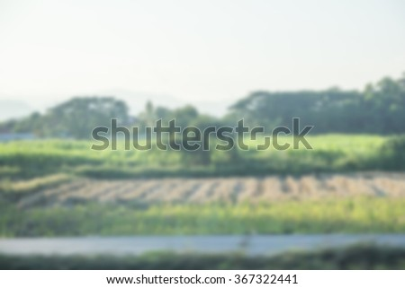 Blur in the view at countryside road for abstract background. - stock photo