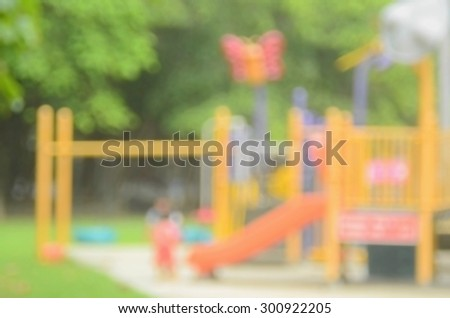 Blur kid playing playground in park abstract background. - stock photo