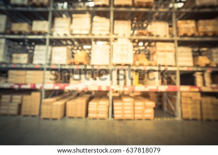 Blur large furniture warehouse in America, row aisles, bins, shelves from floor to ceiling. Defocused industrial storehouse interior full of boxes. Inventory, wholesale, logistic, export. Vintage tone
