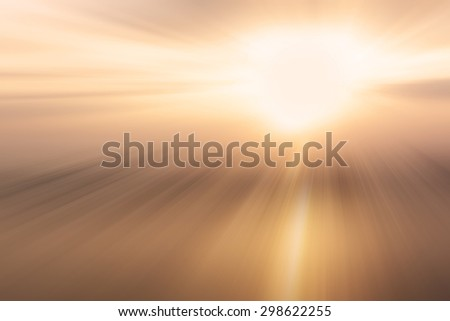 blur light from the sun shining through the clouds in the sky. - stock photo
