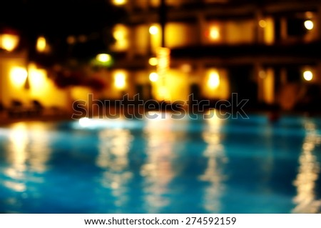 blur light reflection in swimming pool water at night   - stock photo