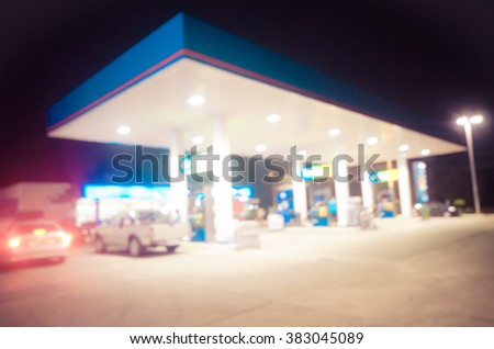 Blur lights, filling gas station at the night. - stock photo