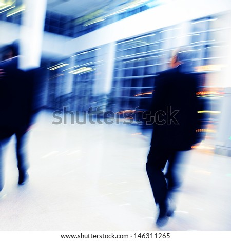Blur motion of businesspeople walking together.