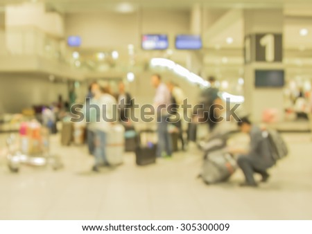 blur motion of passenger with trolley and luggage in airport - stock photo