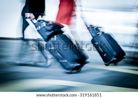 Blur motion of passengers walking at airport in blue color filter - stock photo