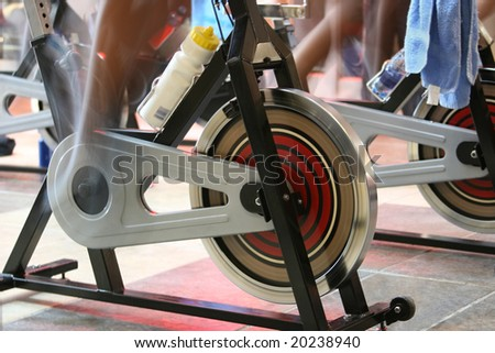 blur motion of people having a training session on spin bikes