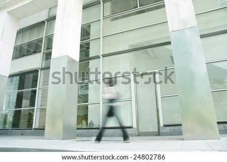 blur motion of people walking in office building - stock photo
