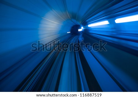 blur motion of tunnel in blue tone - stock photo