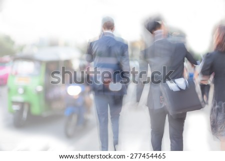 blur motion professional businessmen in road traffic background