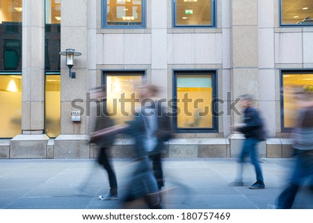 Blur movement: people shopping & walking during the Rush Hour in London, UK.  - stock photo