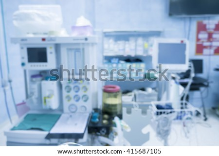 Blur of equipment and medical devices in modern operating room take with art lighting and blue filter,operating room with modern equipment.Operating room ready for operation