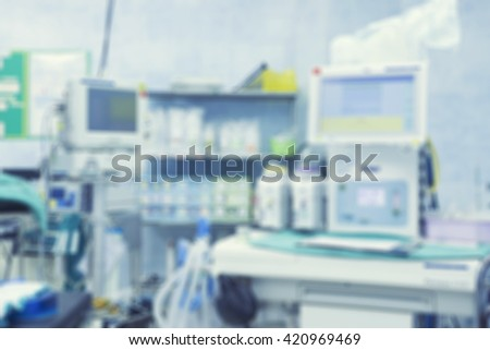 Blur of equipment and medical devices in modern operating room take with art lighting and blue filter,ready for operation,interior of the operating room with the anesthesiology machine  - stock photo