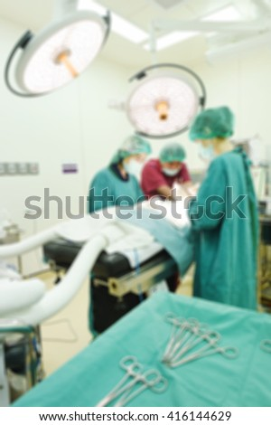 Blur of group of veterinarian surgery in operation room