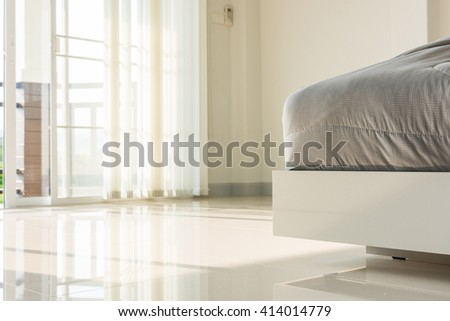 blur of light shines through white curtains in room - stock photo