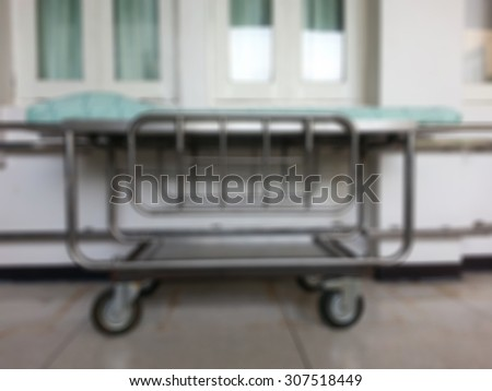 Blur of moving patient beds in hospitals. - stock photo