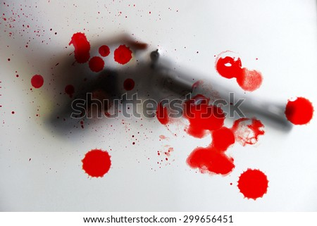 blur of murderer holding a gun and blood - stock photo