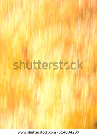 Blur of natural leaf colors in the Fall, with mostly bright yellow, and a bit of orange and red.  Suitable for background or abstract.