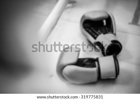 blur of Pair of boxing gloves. black and white filter - stock photo