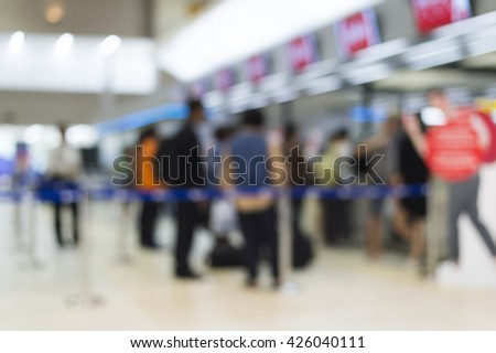 Blur of traveller in airport terminal - stock photo
