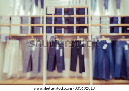 Blur or Defocus image of jeans display in the fashion store,luxury and fashionable brand,blur background of Jeans shirts at shelf in shop, with bokeh for use as Background,vintage retro color - stock photo
