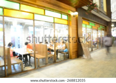 Blur or Defocus image of People Dinner in Restaurant or Food Center with Bokeh - stock photo