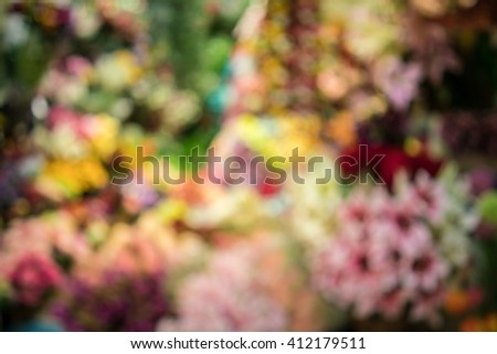 blur or defocus image of product display on shelf, bulk of flowers, use for marketing, shopping background - stock photo